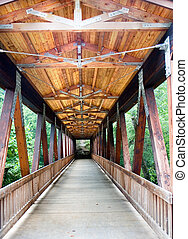 Old Wooden Footbridge - An old wood covered bridge over a...