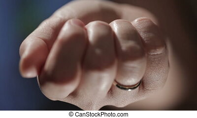 Key hidden in the hand - Woman hand with a wedding ring...