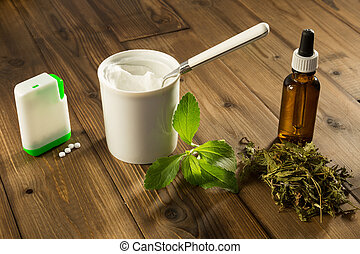 White tablets of stevia - White tablets and green leaves of...