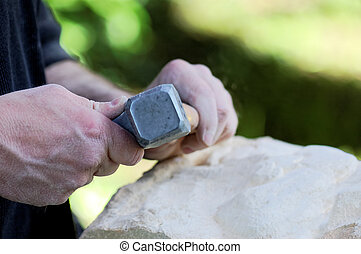 stone sculptor at work