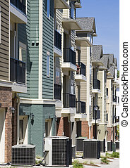 Row Houses and Air Conditioners - A row of townhouses with...