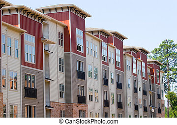 Row of New Townhouses - Rows of new brick townhomes under...