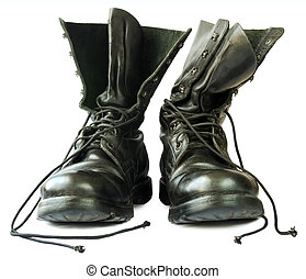 Military style black leather boots on white background.