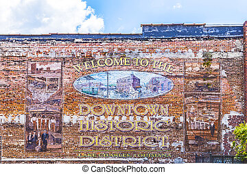 old painted pictures at the brick wall - Lake Charles, USA -...