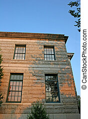 Stone Building in Morning Light - An old stone courthouse in...