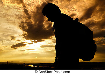 The Dejected Traveler - silhouette of a traveler who is...