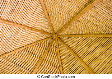 Straw Hut Bamboo Roof - A straw thatched hut roof with...