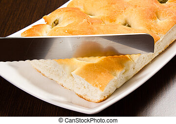 Focaccia with green olives, focaccia is flat oven baked...
