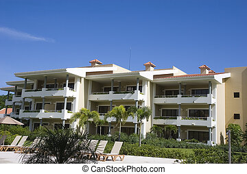 Tropical Resort and Blue - A tropical rsort building against...