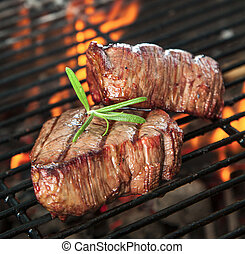 Beef steaks - Delicious beef steaks on grill