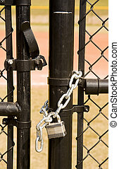 Unlocked Gate - A black chain link fence and an unlocked...