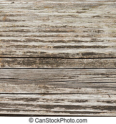 Cracked and shabby wooden surface as abstract background