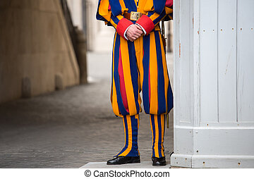 Swiss guard in Vatican - Swiss guard man in Vatican city,...