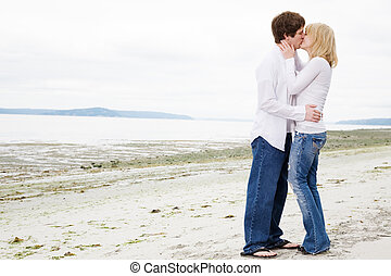 Kissing caucasian couple in love - A caucasian couple in...