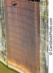 historic Plaquemine gates at river lock - rusty historic...