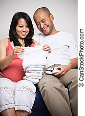 Happy expecting asian couple - A happy expecting asian...