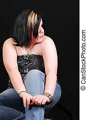 Young woman in studio. - A young little heavy girl in jeans...
