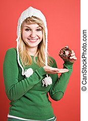 Caucasian girl with christmas ornament - A beautiful...