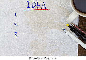 Ideas list on coffee stained tissue paper