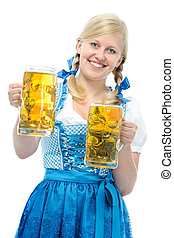 Oktoberfest - Smiling woman with dirndl holds Oktoberfest...