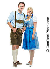 bavarian couple in dirndl - beautiful couple in traditional...