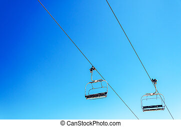 Chairlift and Sky - Looking up at a chairlift with a...