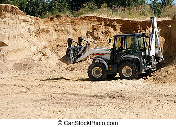 wheeled tractor in a sand quarry - wheeled loader tractor in...