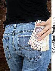 Money in my pocket! - Rearview of a stack of money in the...