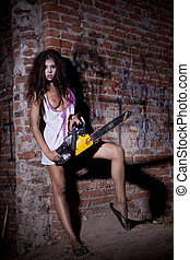 Psychotic woman with a chainsaw covered in blood