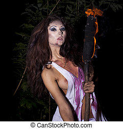 Mysterious sexy woman with torch in hand