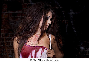 Sinister woman in a bloody shirt