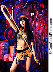 architecture - Stunningly sexy girl posing with tools in the...