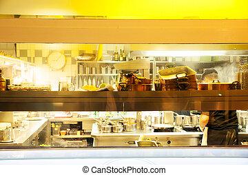 restaurant kitchen - View of a restaurant kitchen from a...