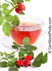 Cup of rose hip tea and berries over white