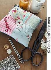 Sewing items with a vintage feel, thread, antique scissors,...