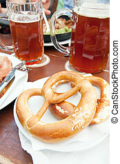 Pretzel and beer - Typical pretzel, German bread with beer