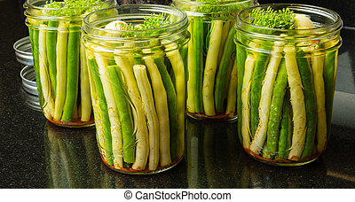 Jars of fresh yellow and green beans for canning - Fresh...
