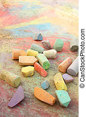 Chalk Scattered on Sidewalk - a collection of rainbow...