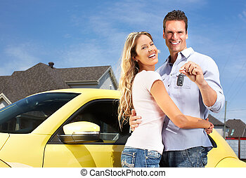 Couple with a car key - Happy young couple near new car with...