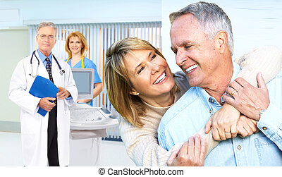 Senior couple at the hospital - Smiling medical doctor with...
