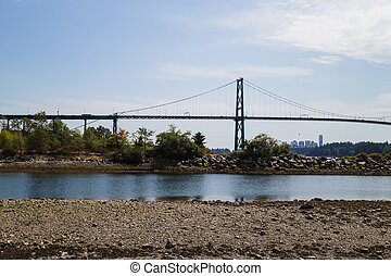 lions gate bridge viewed from ambleside beach - the lions...
