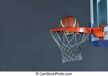 basketball ball and net on grey background - Basketball...