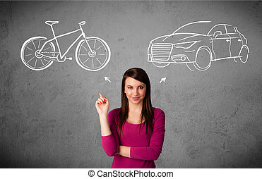 Woman making a choice between bicycle and car - Pretty young...