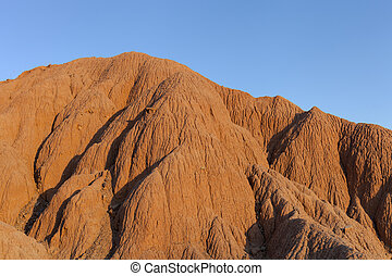Red sandy hill against the blue sky - Sandy hill against the...