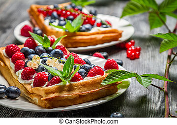 Waffles with cream and blueberry and raspberry