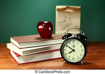 Back to School Items - Clock Apple and Stack of Books on A...