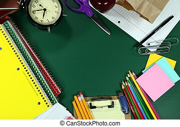 Back to School Items Arranged on a Green Blackboard -...