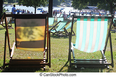 Two empty easy chairs in hyde park on a bright beautiful...