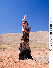flamenco in malpais - dancer posing against natural...