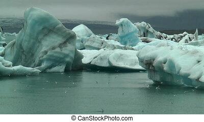 blue icebergs at jokulsarlon icelan - blue icebergs at...